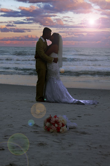 sunset kiss on beach between bride and groom myrtle beach sc