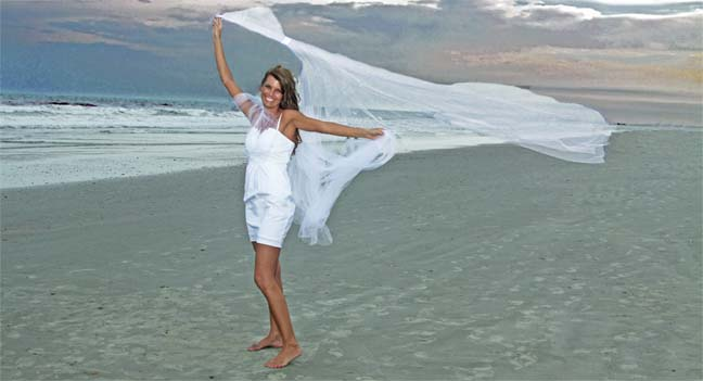 bride with tulle blowing in the wind