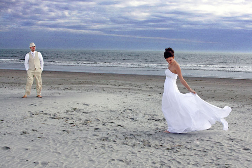 groom admires his bride on myrtle beach sc