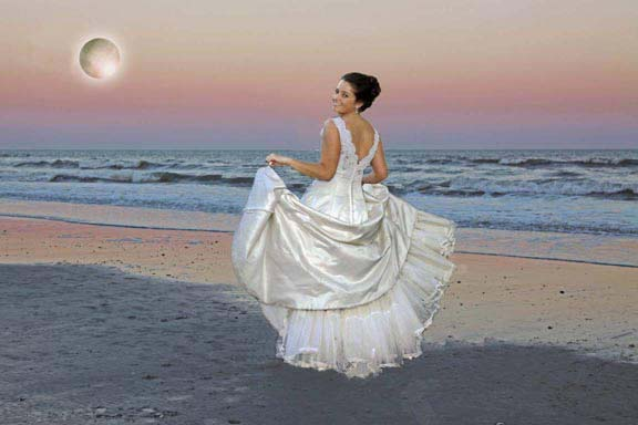 bride takes moonlight stroll on beach
